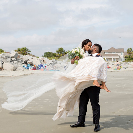 Brittney and Ike wedding kissing on beach