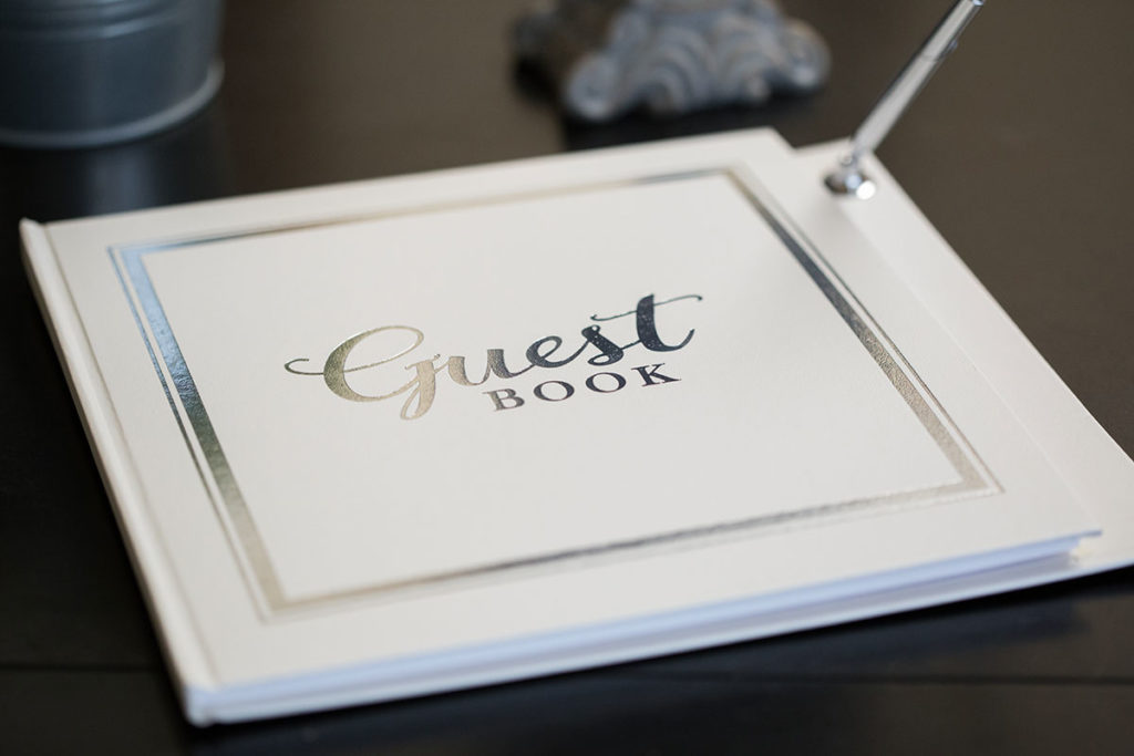 white wedding guest book with silver accents