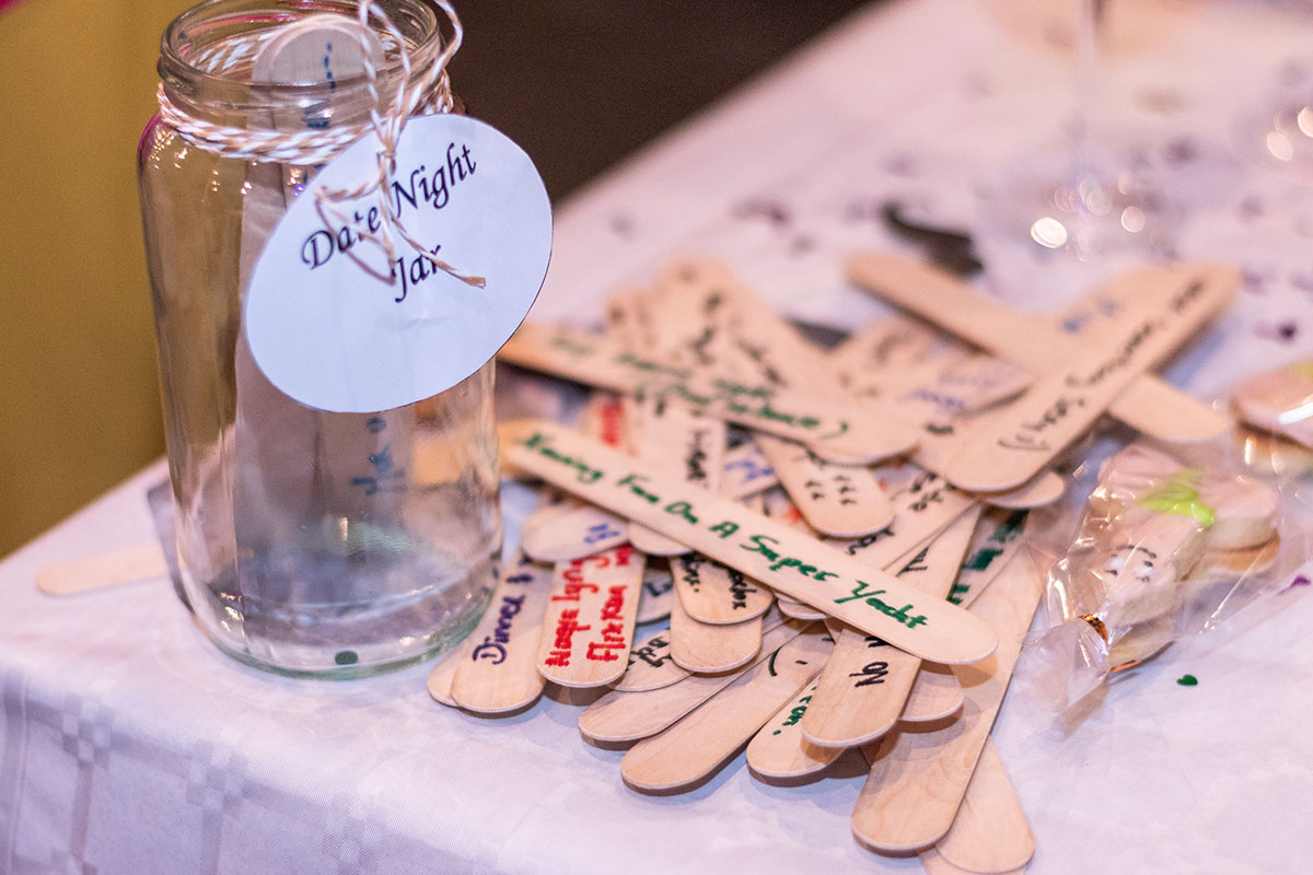 date night idea jar with suggestions on popsicle sticks