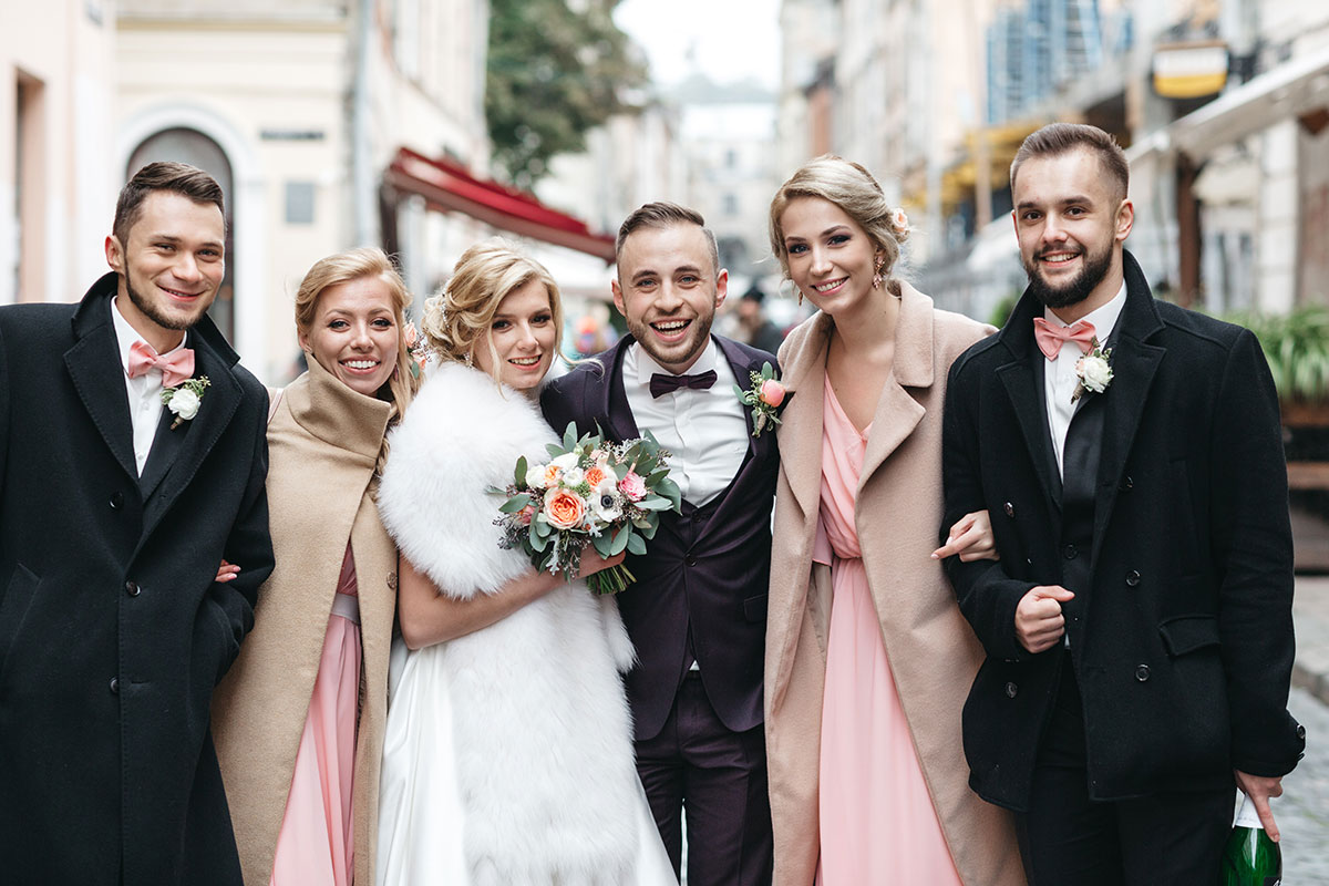bride, groom, and their two groomsmen and bridesmaids in clothed for a winter wedding