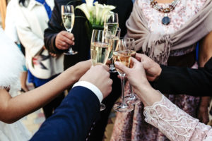 champagne cheers with wedding guests
