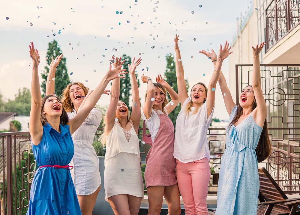 bridesmaids celebrating bachelorette with confetti