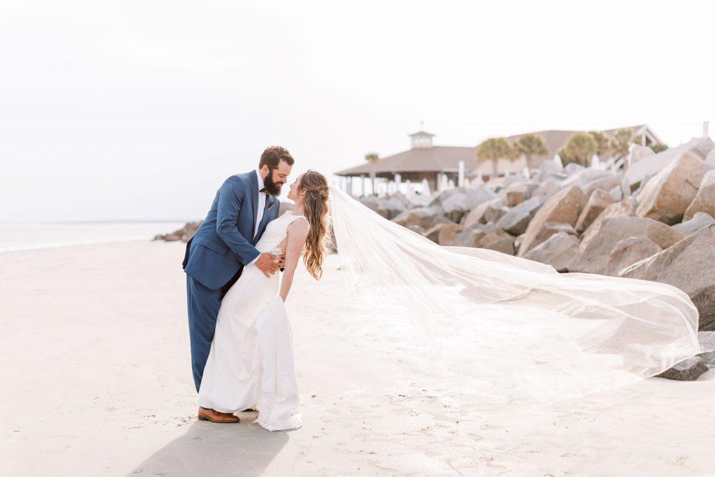 Seaside wedding beach shot bride and groom